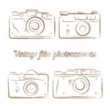Vector set of vintage film photocameras. Vector set of four vintage film photocameras. Element for design, logo, studio, template and other. Live line draw style Stock Image