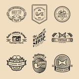Vector set of vintage hipster logo. Retro icons collection of bicycle, moustache, camera etc. Royalty Free Stock Photos