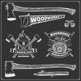 Vector set of vintage Lumberjack logos, labels, emblems and design elements. Axes and saws. Royalty Free Stock Photos