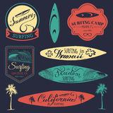 Vector set of vintage surfing logos,signs for textile,t-shirts print etc. Freedom, California, Hawaii typography poster. Royalty Free Stock Image