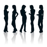 Young women silhouettes. Vector set of young women gesturing silhouettes stock illustration