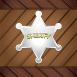 Vector Sheriff's badge on a wooden background. Stock Photography