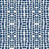 Vector shibori seamless print. Beige white dot pattern. Vector shibori spotty seamless print. Organic hipster batik background. Tie dye tile. Geometric cute Royalty Free Stock Photo
