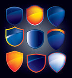 Vector shield collection with glossy reflections in blue and ora Stock Image
