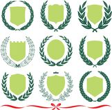 Vector shields and laurel wreaths set royalty free illustration