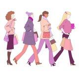 Vector shopping girls. Illustration shopping girls on white. Vector Stock Images