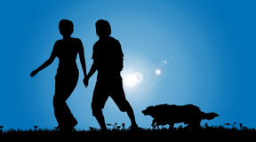 Vector silhouette of a couple with a dog. Royalty Free Stock Photos