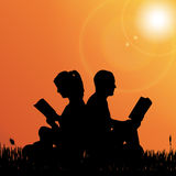 Vector silhouette of couple. Vector silhouette of a couple who reads in nature Royalty Free Stock Photo