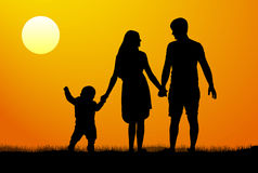 Vector silhouette of a family at sunset. Man woman child at dawn Stock Photo