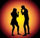 Vector silhouette of fighting couple. Detailed vector silhouette of fighting young couple Stock Image
