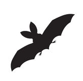 Vector silhouette of a flying bat Stock Photo