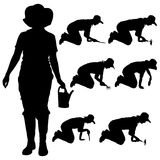 Vector silhouette of a gardener. Royalty Free Stock Image