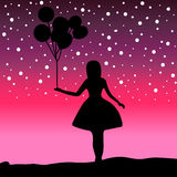 Vector Silhouette girl holding a balloon Royalty Free Stock Image