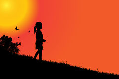 Vector silhouette of a girl. Vector silhouette of a girl at sunset Royalty Free Stock Images