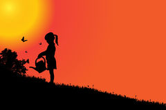 Vector silhouette of a girl. Vector silhouette of a girl at sunset Stock Image