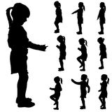 Vector silhouette of a little girl. Stock Images