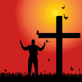 Vector silhouette  of man. Vector silhouette of man at the cross at sunset Stock Photography