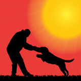 Vector silhouette of a man with a dog. Royalty Free Stock Image