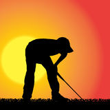 Vector silhouette of a man who plays golf. Royalty Free Stock Images