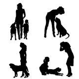 Vector silhouette of people with dog. Stock Photos