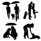 Vector silhouette of people with dog. Stock Images