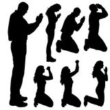 Vector silhouette of people who pray. Stock Photos