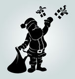 Vector silhouette of Santa Claus with a gifts Stock Images