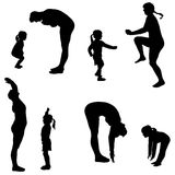 Vector silhouette of a woman with a child. Stock Photos