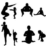 Vector silhouette of a woman with a child. Stock Photo