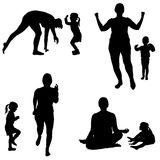 Vector silhouette of a woman with a child. Royalty Free Stock Photo