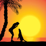 Vector silhouette of a woman with a dog. Stock Photography