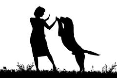Vector silhouette of a woman with a dog. Royalty Free Stock Photos