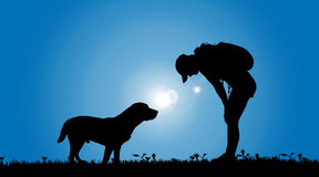 Vector silhouette of a woman with a dog. Stock Photos
