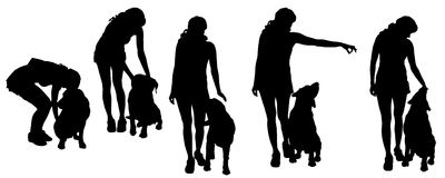 Vector silhouette of a woman with a dog. Royalty Free Stock Image