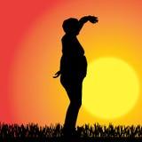 Vector silhouette of a woman. Stock Photos