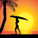 Vector silhouette of a woman with a surfboard. Stock Image