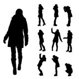 Vector silhouette of woman in winter clothes. Royalty Free Stock Photo