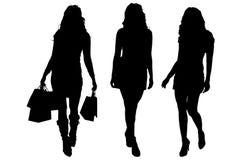 Vector silhouette of a women. Stock Photos