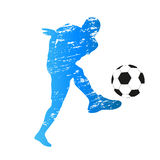 Vector silhouette of young soccer player. Scratched vector silhouette of young soccer player Royalty Free Stock Image