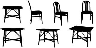 Vector silhouettes of chairs and a table. Stock Photos
