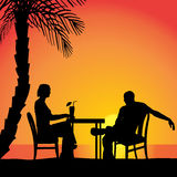 Vector silhouettes of couple. Vector silhouettes of couple sitting at the table Royalty Free Stock Photos