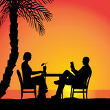 Vector silhouettes of couple. Vector silhouettes of couple sitting at the table Royalty Free Stock Photo