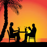 Vector silhouettes of couple. Vector silhouettes of couple sitting at the table Stock Photo