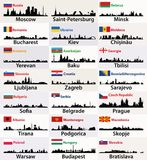Vector silhouettes of East European cities skylines with countries flags Royalty Free Stock Image