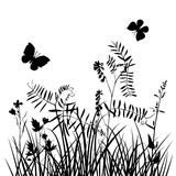 Vector silhouettes of flowers and grass with butterflies Royalty Free Stock Photography