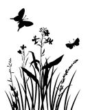 Vector silhouettes of flowers and grass with butterflies Royalty Free Stock Photo