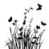Vector silhouettes of flowers and grass with butterflies Royalty Free Stock Photos