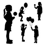 Vector silhouettes of girls with balloons. Stock Photo