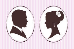 Vector silhouettes of groom and bride Stock Images