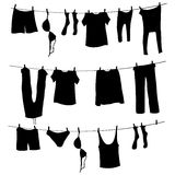 Vector Silhouettes of Laundry on a Rope Stock Photos